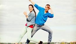 couple of teenagers dancing outside